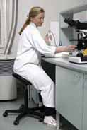 Lab technician using a Salli Saddle Chair