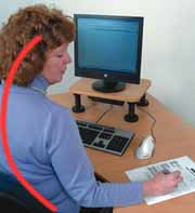 Bad posture working with papers at a computer